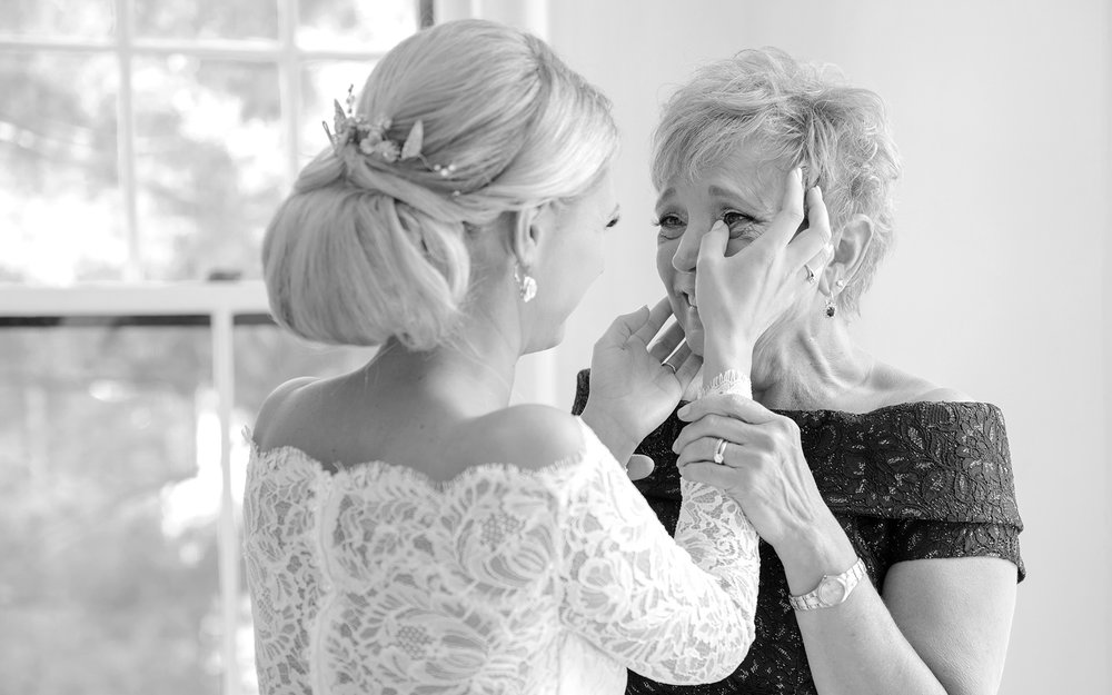 An emotional moment with a bride and her mother