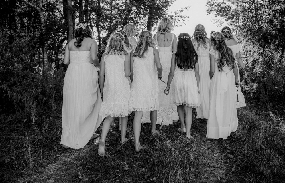 Bridesmaids and junior bridesmaids in white lace