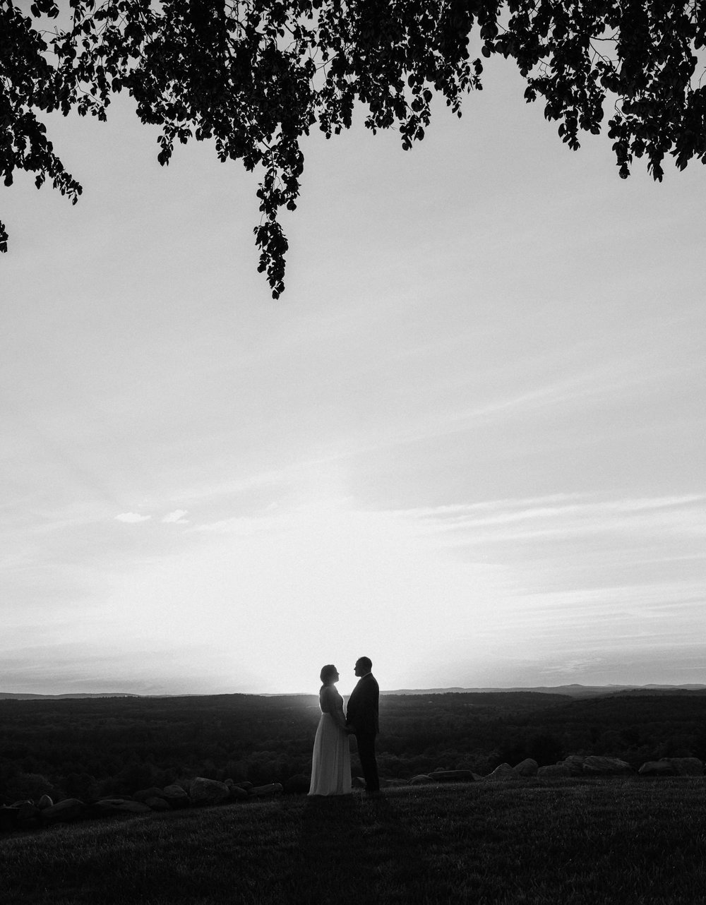 A bride and groom at sunset