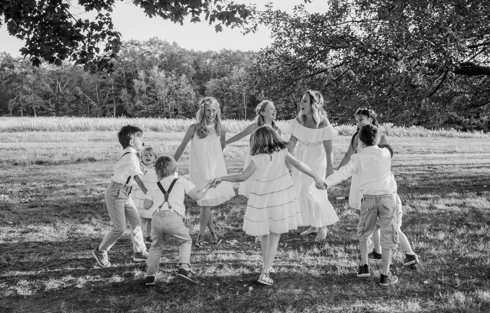 Ring around the rosie led by a bridesmaid