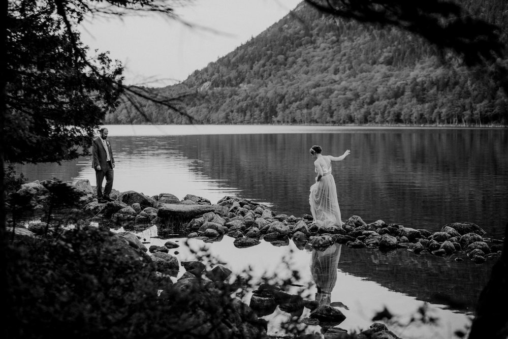 A bride walks at Jordan Pond in Acadia National Park
