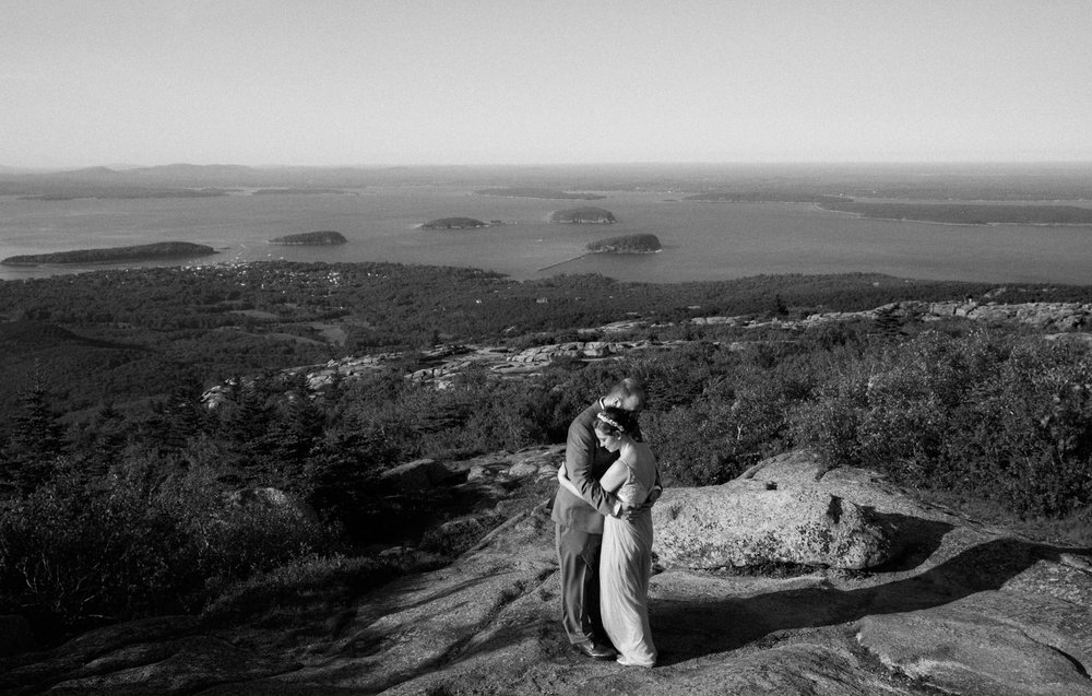 A bride and groom elope on top of Cadillac Mountain in Acadia Park