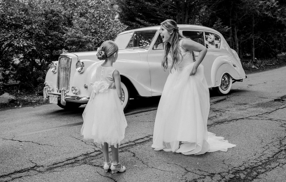 Excited bride sees an antique car surprise by her groom