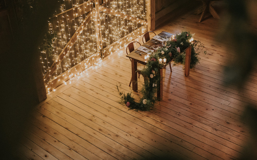 The head table at a barn wedding