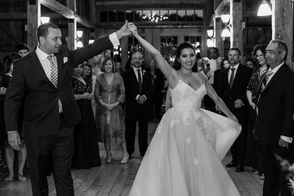 A bride and groom have their first dance