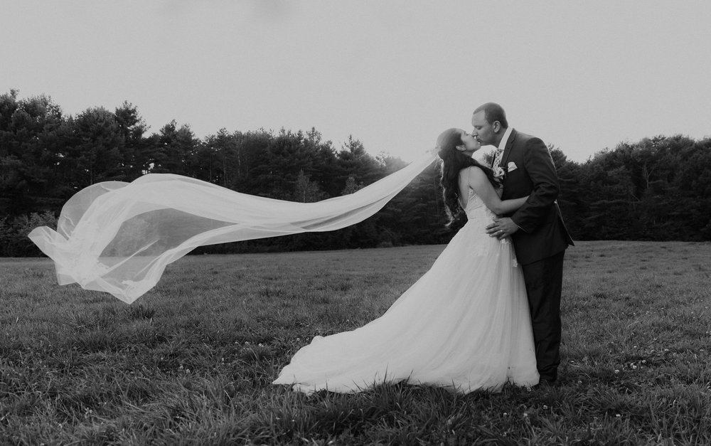 Stunning bride and groom in a field in maine