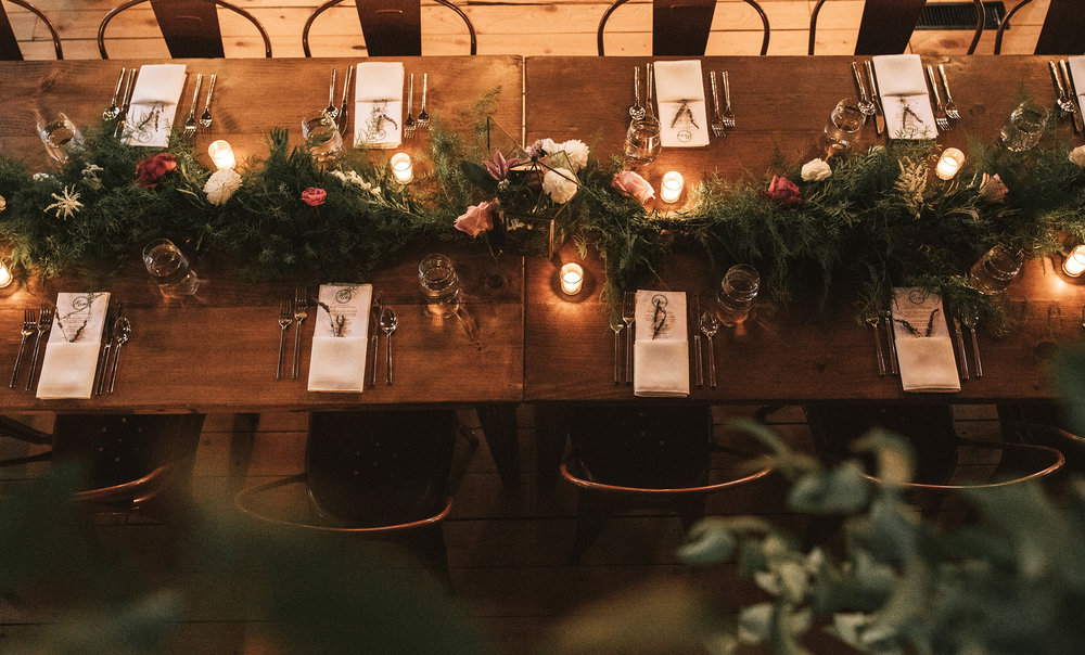 A guest table at a barn wedding reception
