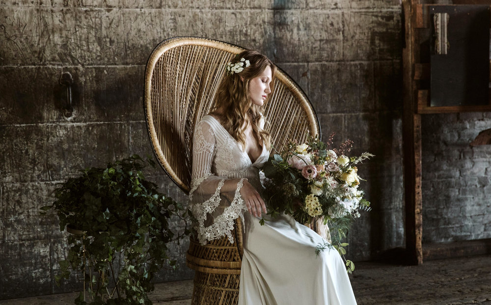 Bohemian bride in a peacock chair
