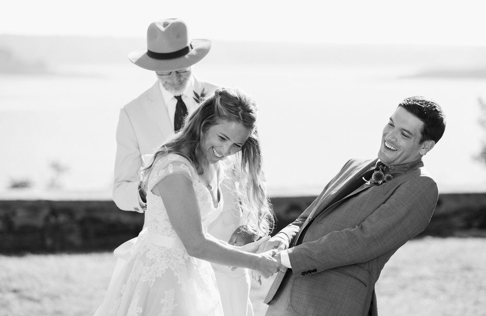 Maine bride and groom laughing during their ceremony