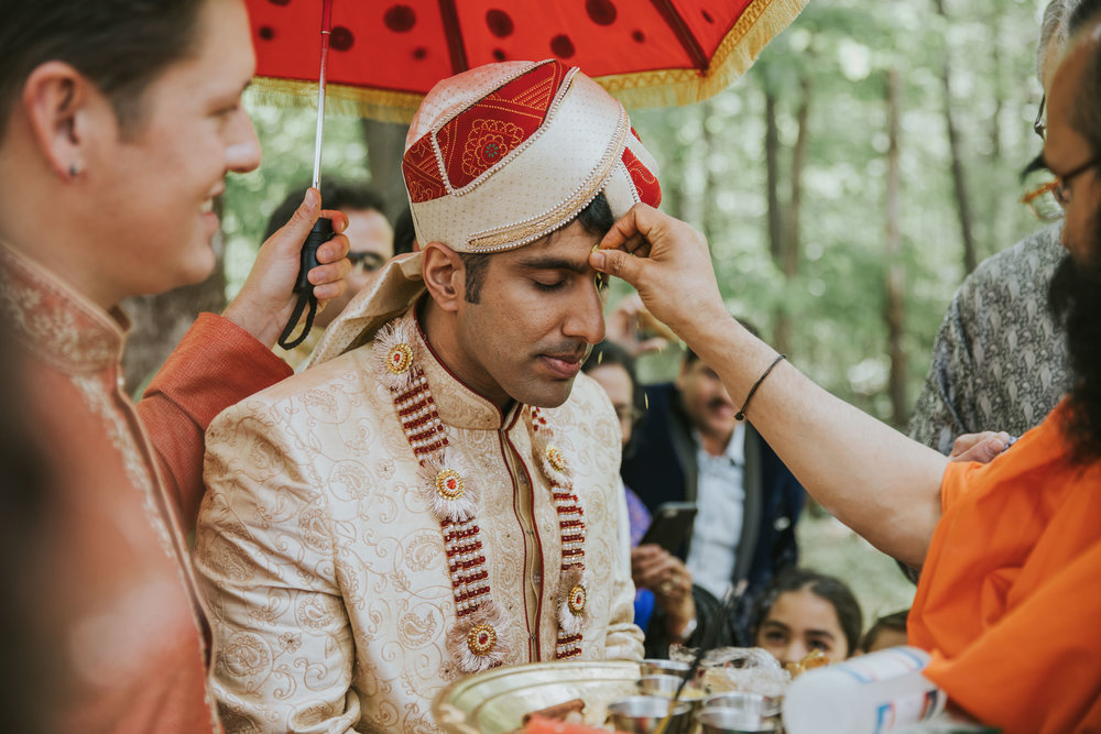 Indian groom preparing for ceremony