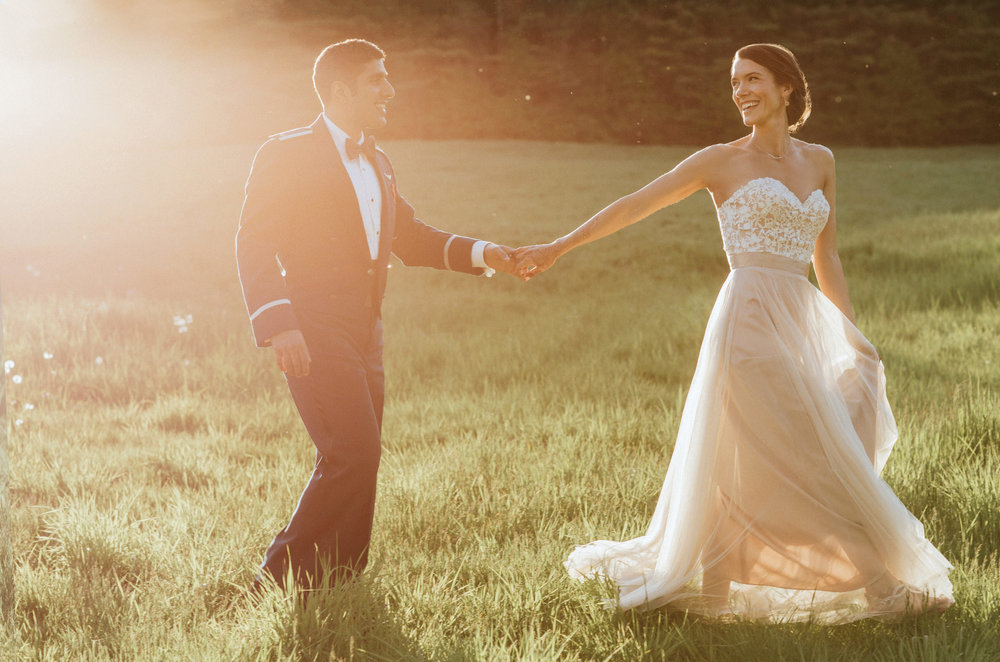 Bride and groom in lovely sunset light after their wedding
