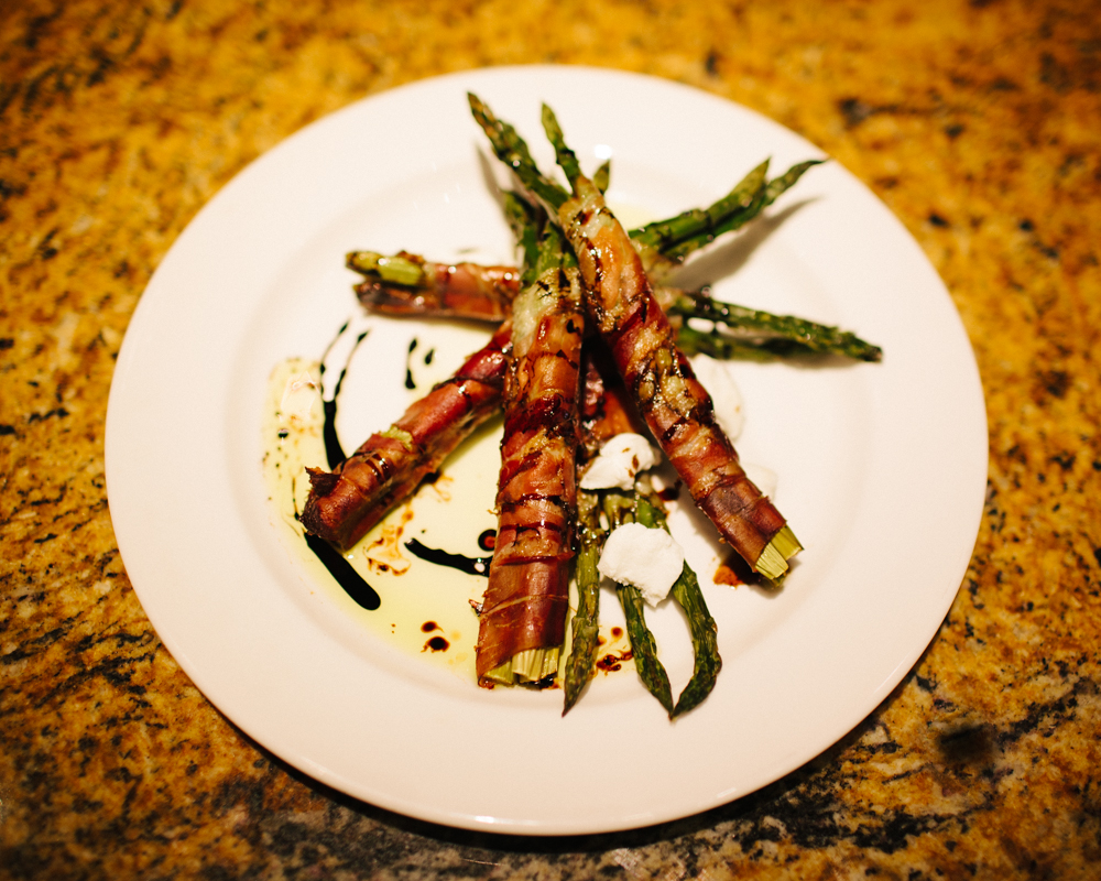 Prosciutto wrapped asparagus with balsamic reduction, goat cheese, and white truffle oil