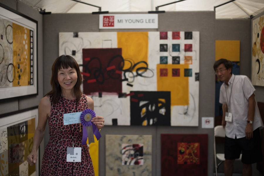Artist MiYoung Lee and her booth from Art City Austin 2015, photograph by Rich Merritt.jpg