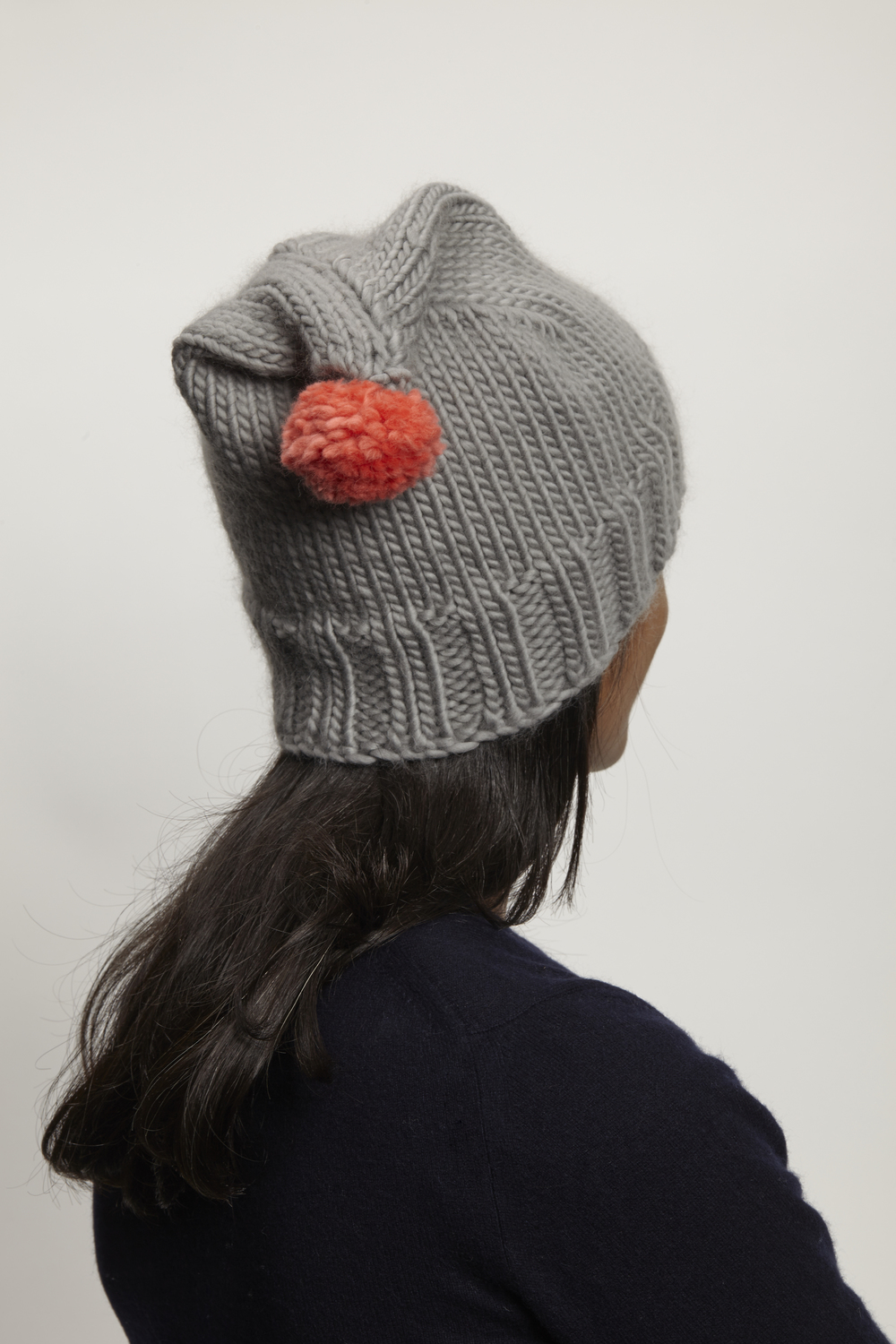 One of many ideas: grey hat - coral pompom