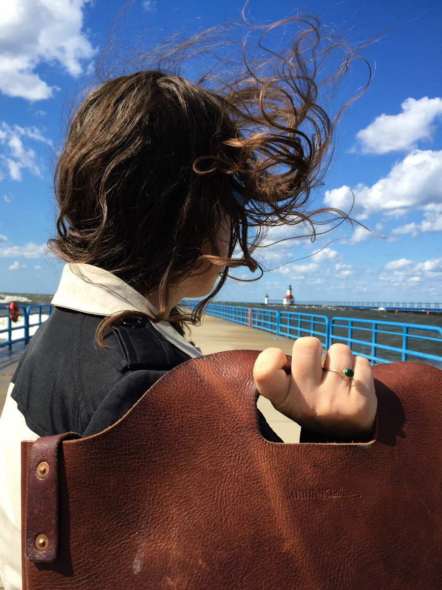 The autumn wind whipping my hair around. I had to take off the hat or hold it on constantly if I wanted to keep it for future wear and not to provide a new hat for the sea gulls.
