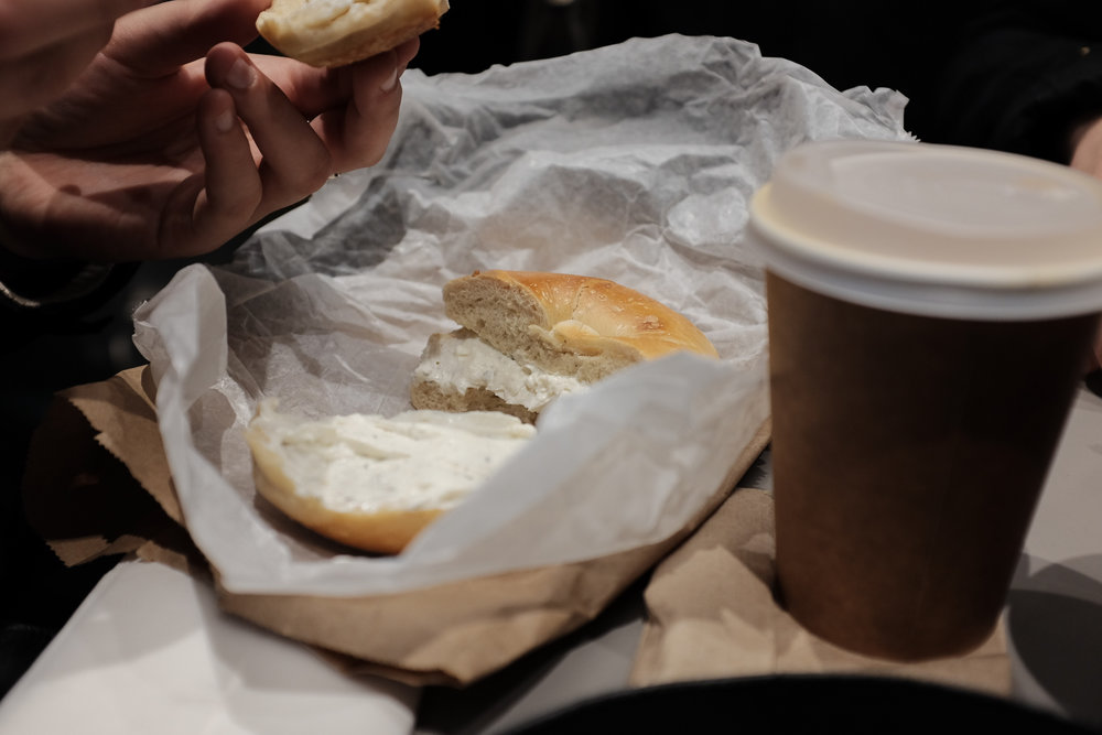 A bagel with savory cream cheese.