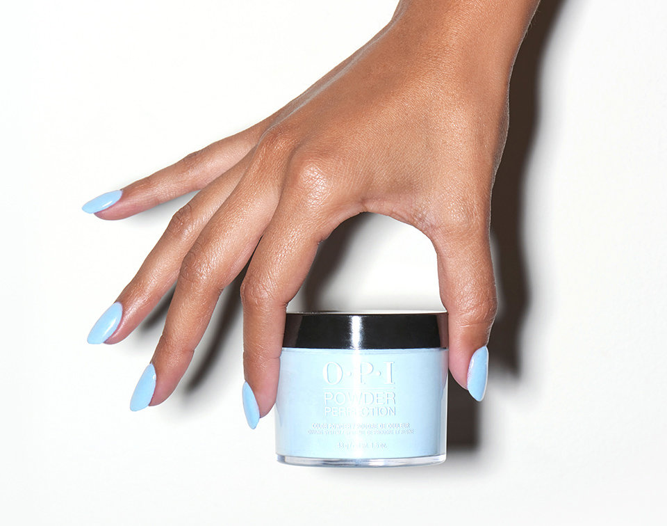 OPI Powder Perfection - OPI Powder Refection is now available at Pinky's Nails Salon.It uses a unique technology that is different from the technology found in acrylic enhancement products, such as Absolute. Powder Perfection does not use a liquid monomer initiator found in acrylic systems like Absolute. Instead, a liquid resin or base coat is used for adhesion. Powder Perfection then requires an Activator to accelerate the curing of the Base Coat and powders, and initiate the reaction with the Top Coat. This makes the Powder Perfection system ideal for protective overlays on the natural nail.