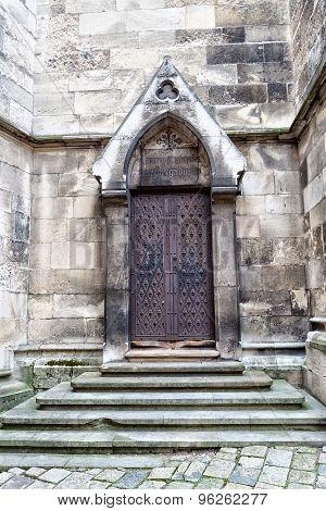 wrought_iron_vintage_door_stone_steps_church_stone_walls_cg9p6262277c.jpg