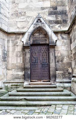 wrought_iron_vintage_door_stone_steps_church_stone_walls_cg9p6262277c.jpg