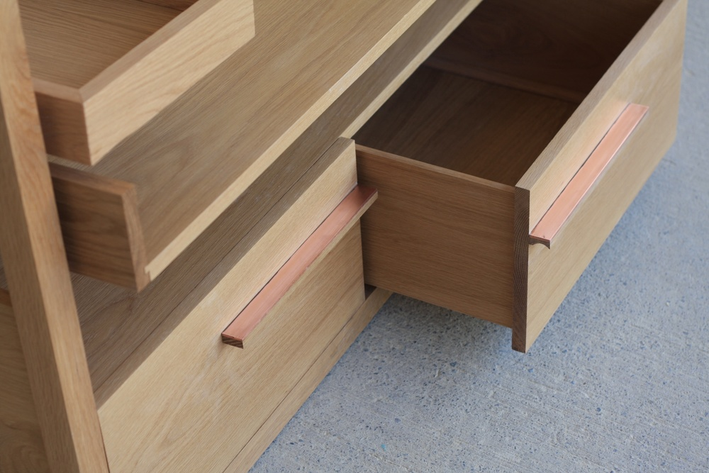 Solid oak copper detailing, draw pulls, shelf supports