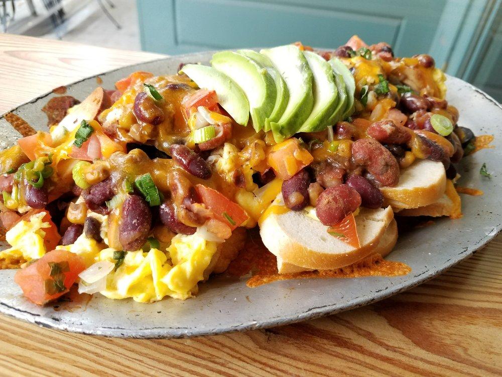 Loaded nachos! Choice of tofu or egg scramble and vegan or dairy cheddar.