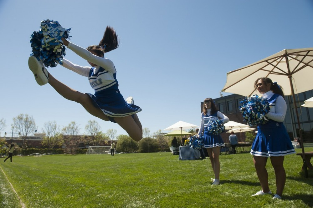 The Blue Devils Drum Corps and MU cheerleaders entertain press during a tailgate lunch at Monsters University Long Lead Press Days at Pixar Animation Studios. Emeryville, California. April 9, 2013 (Photo by Jessica Lifland/Pixar)