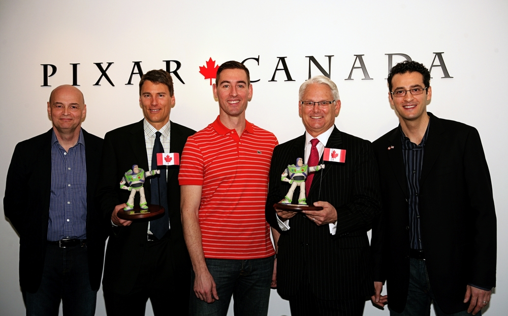 Pixar Canada's Chief Technical Officer Darwyn Peachey, Mayor Gregor Roberston, Pixar Canada's Creative Director Dylan Brown, Premier Gordon Campbell, and Pixar Canada's General Manager Amir Nasrabadi, pose for photographs after the first Pixar Canada press program, which entailed announcing plans to provide animation to support Pixar Animation Studios franchises such as Toy Story and Cars, on April 20, 2010 at Pixar Canada in Vancouver, British Columbia, Canada. (Photo by Deborah Coleman / Pixar). Used with permission. All rights reserved.