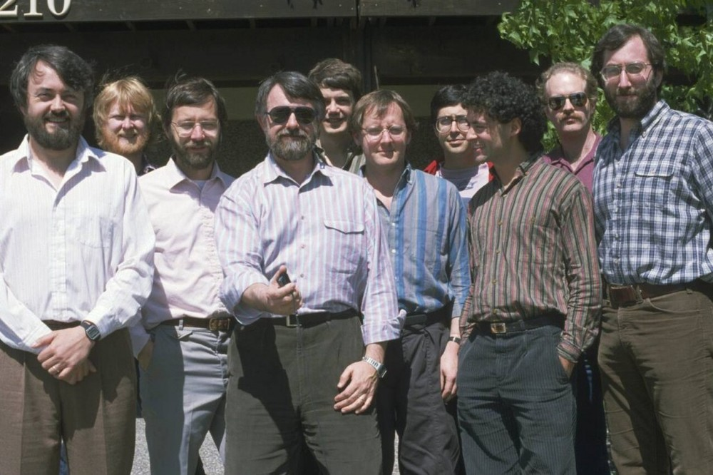 The Graphics Group in about 1985 or maybe 1984. From left: Loren Carpenter, Bill Reeves, Ed Catmull, Alvy Ray Smith, Rob Cook, John Lasseter, Eben Ostby, David Salesin, Craig Good, Sam Leffler © Pixar Animation Studios. All rights reserved.