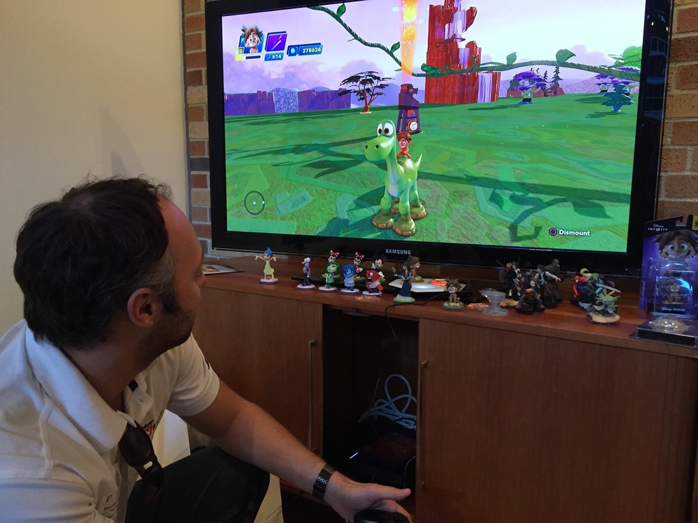 A Disney rep demonstrates the new Spot game piece for Disney Infinity at Pixar in October 2015.