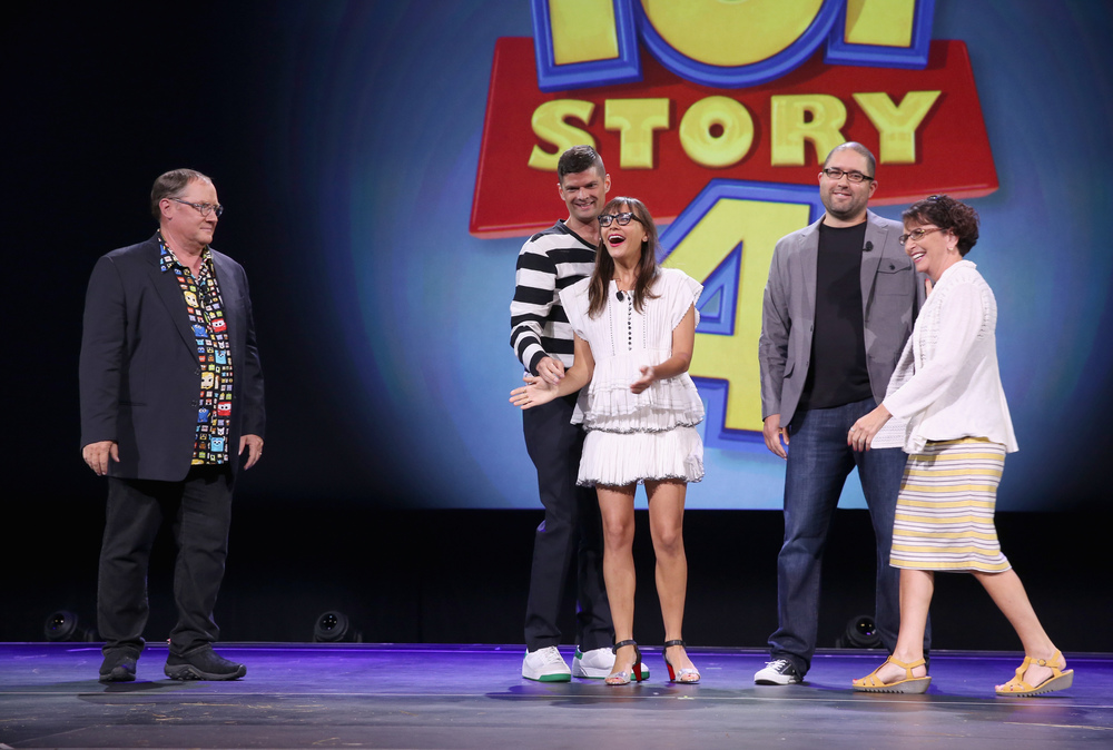 "ANAHEIM, CA - AUGUST 14, 2015:  (L-R) Director John Lasseter, writers Will McCormack and Rashida Jones, co-director Josh Cooley and producer Galyn Susman of TOY STORY 4 took part today in ""Pixar and Walt Disney Animation Studios: The Upcoming Films"" presentation at Disney's D23 EXPO 2015 in Anaheim, Calif.  (Photo by Jesse Grant/Getty Images for Disney)"