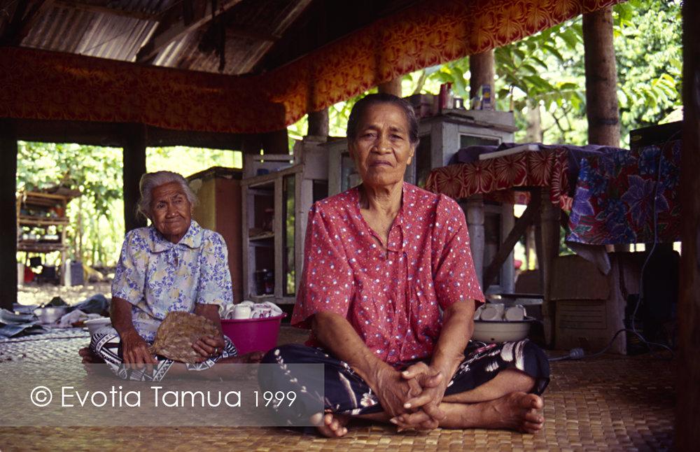 1999 Salelesi, Upolu, Samoa. Numi Vamaua and Niu Elia waiting at the monthly village meeting.