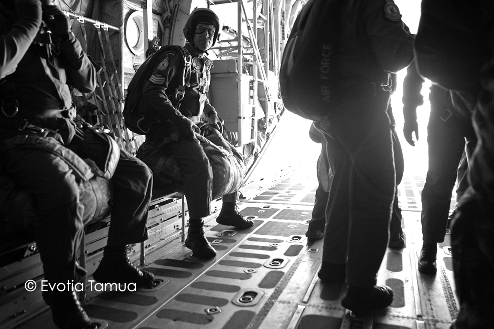 On board a NZ Airforce hercules airplane with the back doors open with parachuters getting ready to jump. Whenuapai, Auckland.