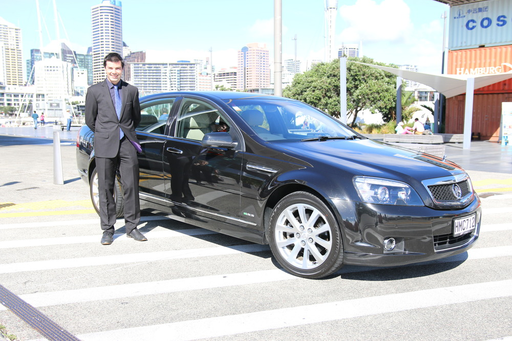 Driver Stuart with luxury sedan