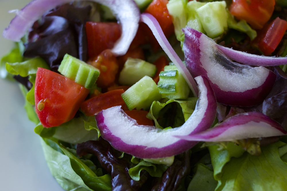 House Green Salad     Mixed greens, tomatoes, cucumbers, and red onions tossed in house   salad dressing.