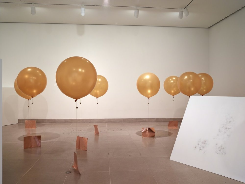 Chosil Kil @ Dallas Museum of Art Concentrations 58, 2015 Latex balloons, Hi-Float, helium, elastic cord, copper sheet