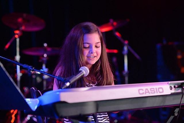 Maddy is already writing her own songs and performing after only a year of lessons from us. By the way, she was not nervous AT ALL for her debut performance! 😀🎹 #rockhomelessons