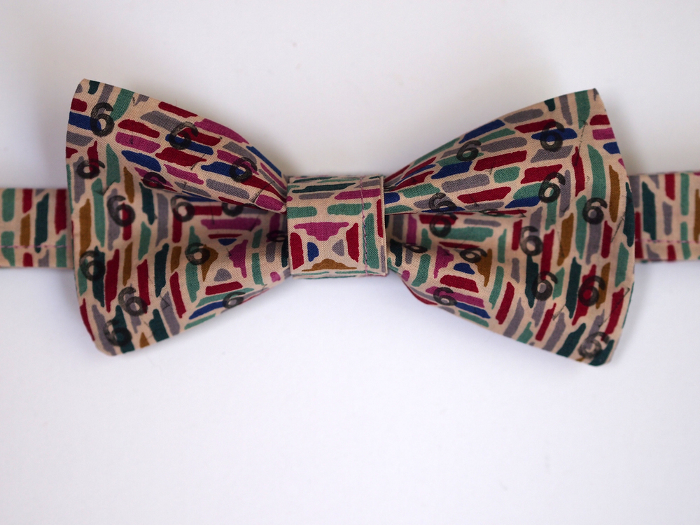 Finished bow tie with lots of 6s printed on it (only on one side!)