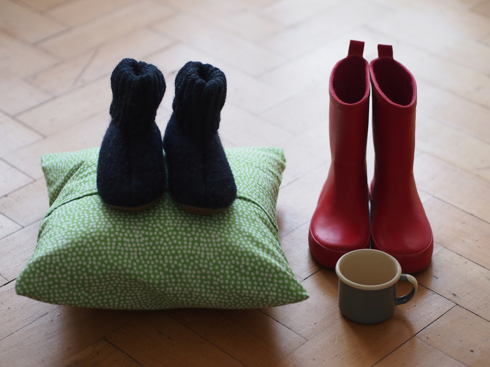 For Elfie's first day we were asked to bring a cushion for rest time, a water cup, wellies and woolen slippers.