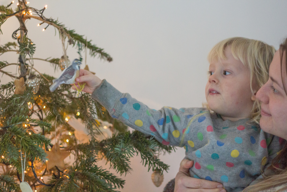 Decorating the tree with a toddler