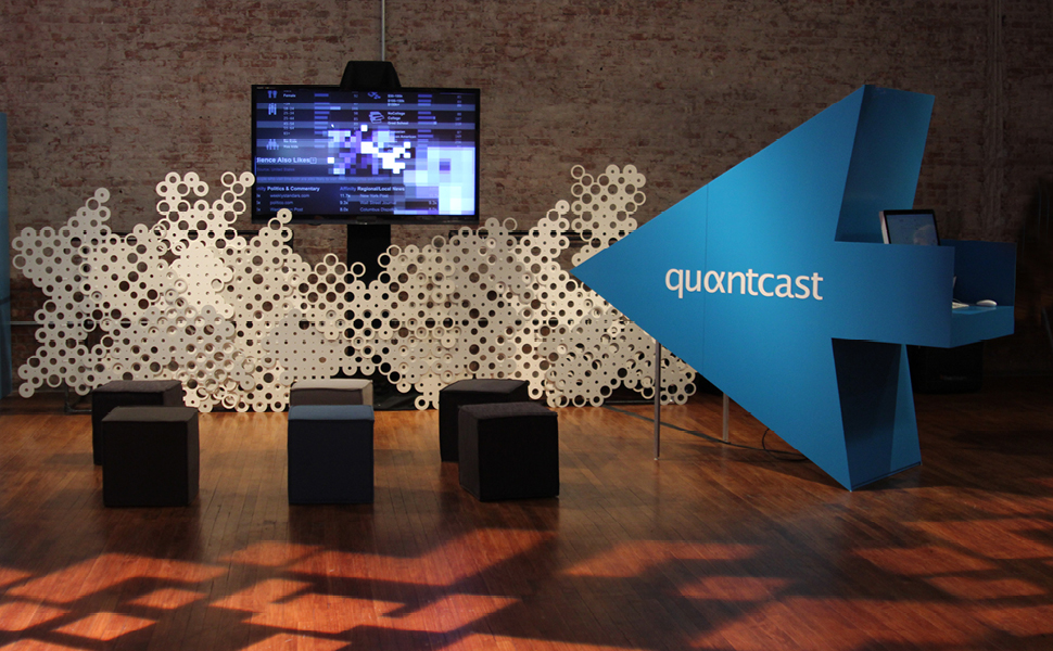 Quantcast's booth at Internet Week 2012 featured custom cases and video that explained their technology.