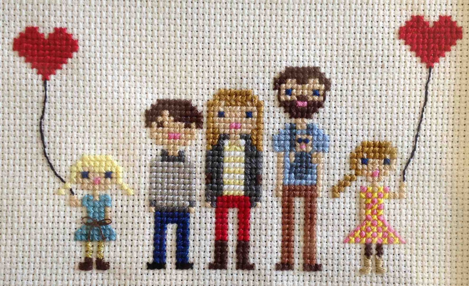 cross stitched family close up