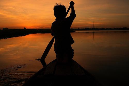 Boat Boy Sunset (Cambodia) by nabilkannan