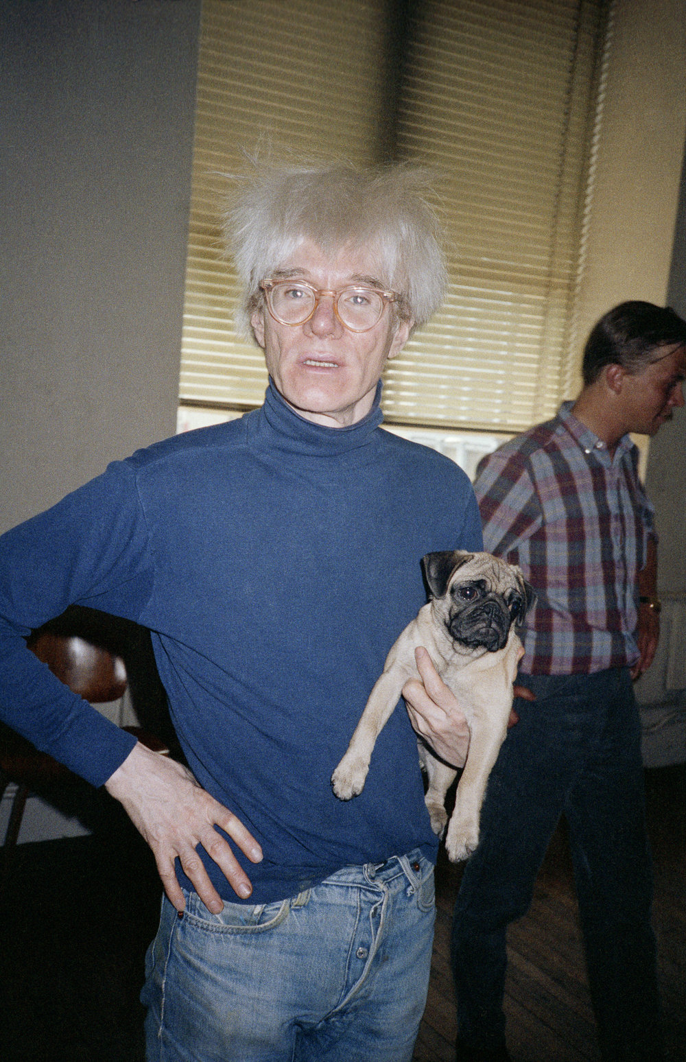 Andy Warhol with Brigid Berlin's dog, Fame. (1983)