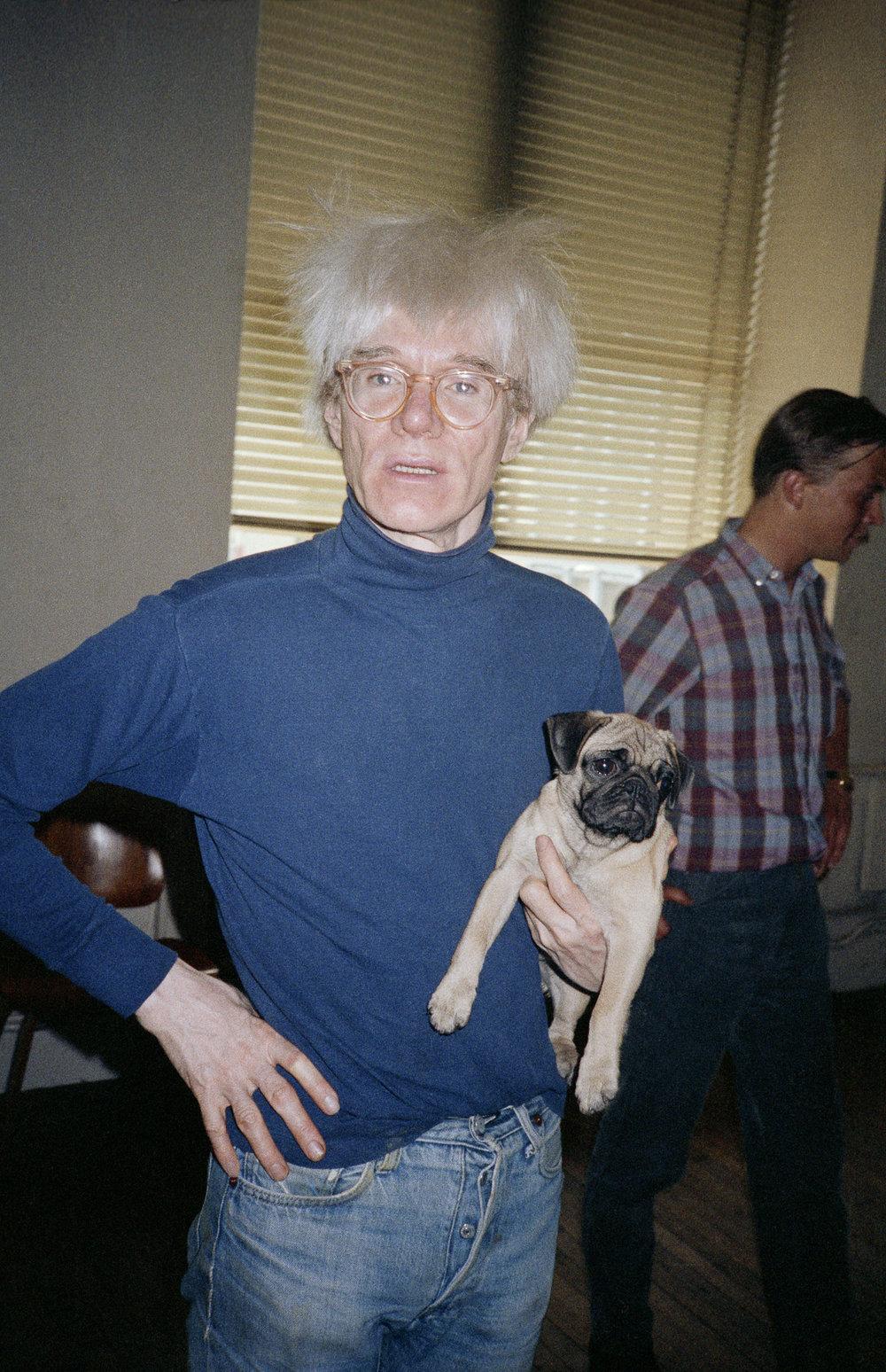Andy Warhol with Brigid Berlin's dog, Fame. (1983)