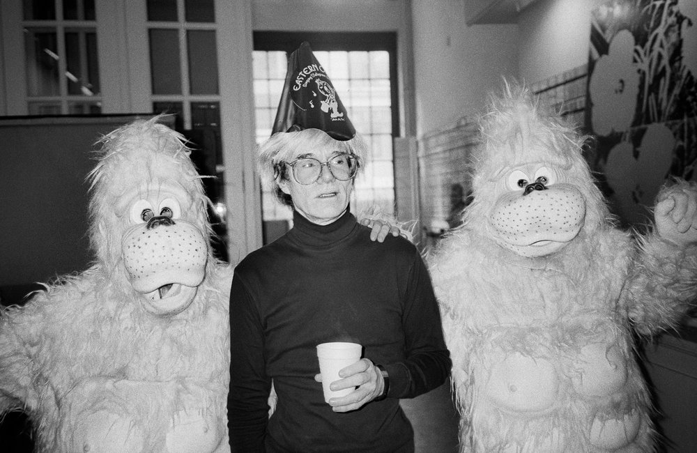 Andy Warhol's birthday with pink orangutans the designer Halston sent over to surprise him for his birthday. (1985)