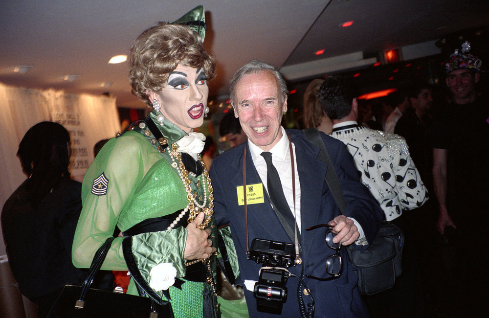 Performance artist John Epperson, AKA Lypsinka, with photographer Bill Cunningham at the Love Ball, Susanne Bartsch's benefit for the Design Industries Foundation for AIDS. (1989)