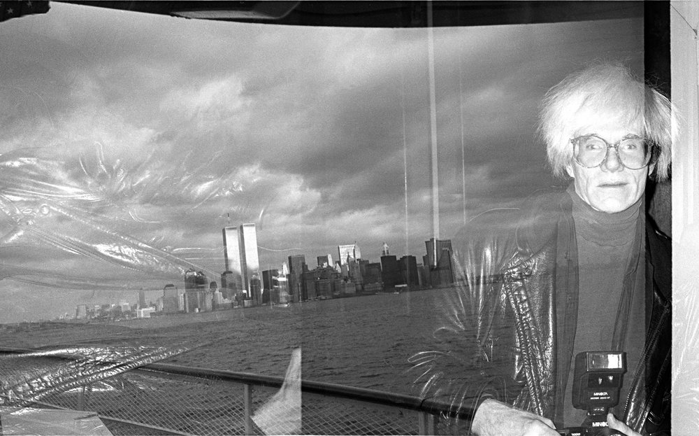 Andy Warhol on an East River boat cruise. Accidental double exposure. (1986)