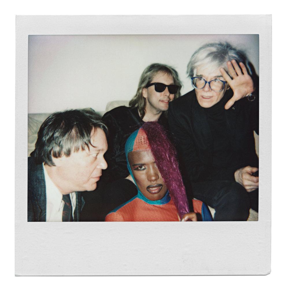 Diamantaire John Reinhold, author Beauregard Houston-Montgomery, singer Grace Jones and Andy Warhol. (1985)