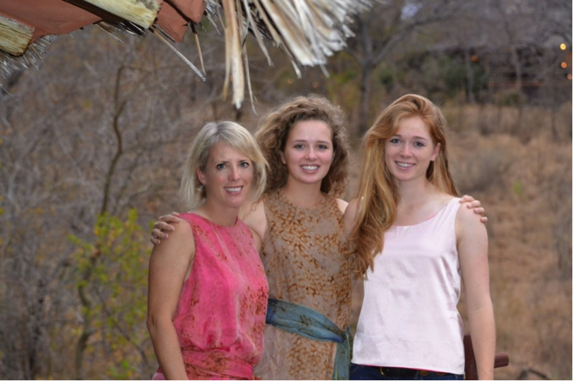Mom and her daughters in Africa, wearing Camilla OlsonReversible tank and scarf transforms white jeans.