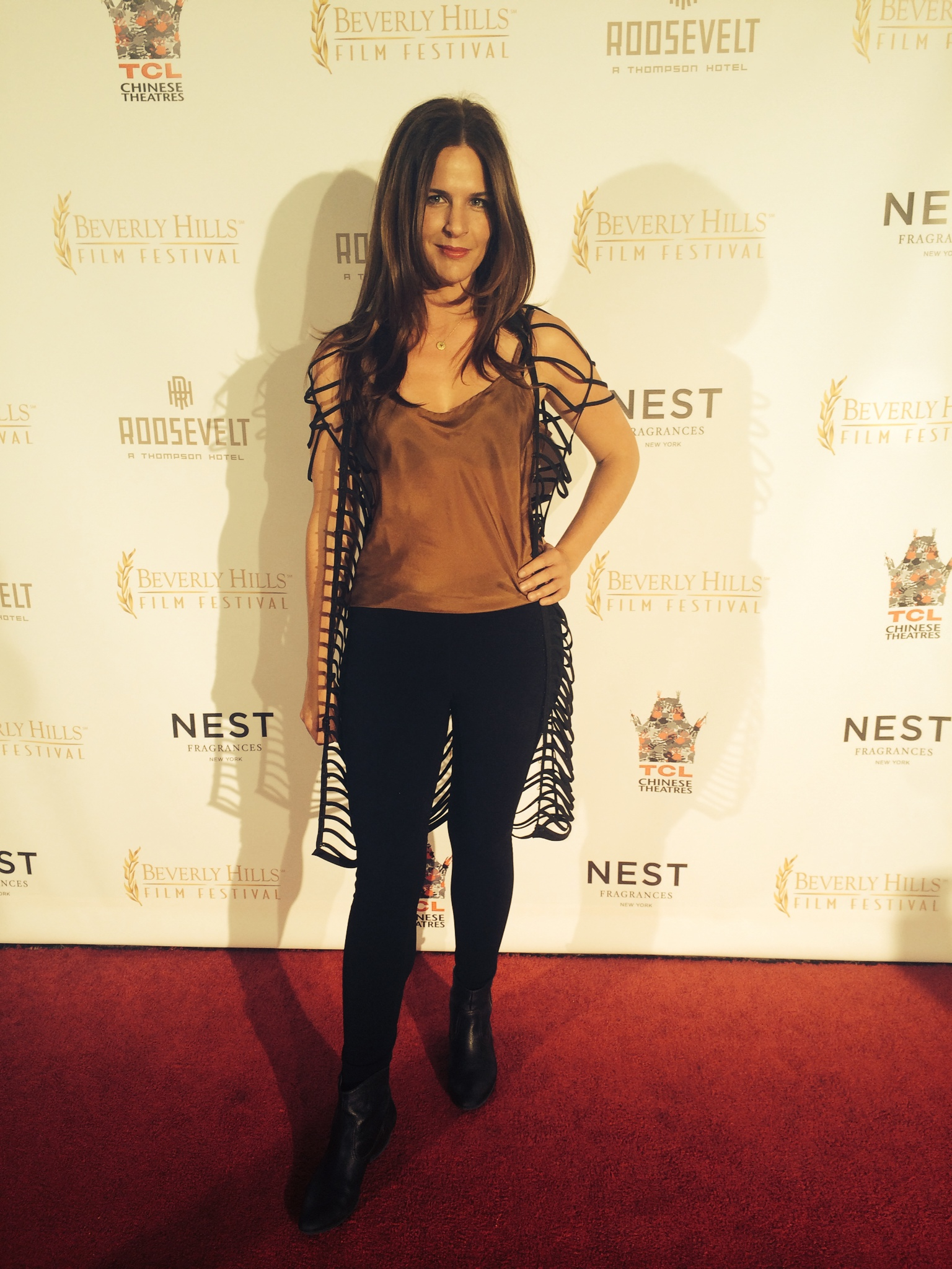 Anne Hamilton wears Camilla Olson Cage jacket over her work wear to her screening at Beverly Hills Film Festival.